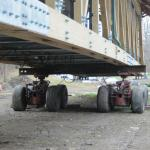 This dual set of wheels are under the west end of the bridge.